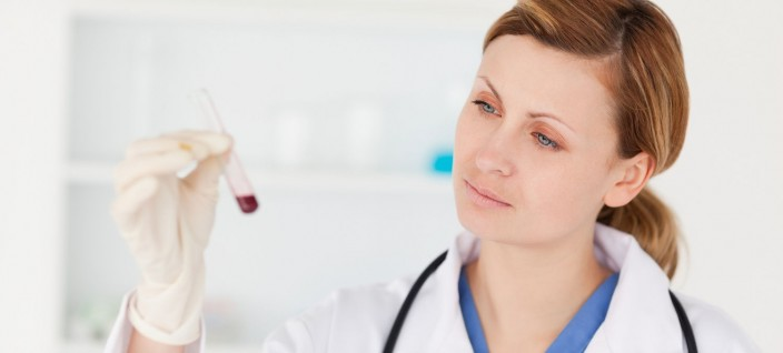 doc examining test tube