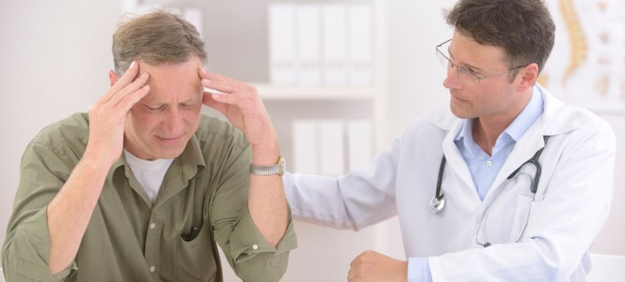 Doctor comforting mature male patient